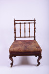 An overscale Gillows walnut and leather side chair