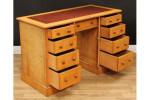 An Arts & Crafts period oak desk