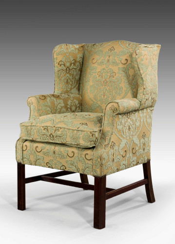 20th Century Mahogany Framed Wing Chair.