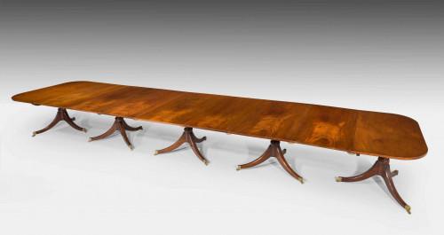 A George III Associated Five Pillar Dining Table