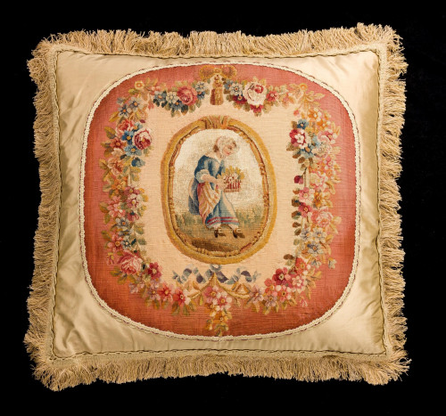 Cushion: 18th Century, Wool. A Young Woman Carrying a Basket of Flowers