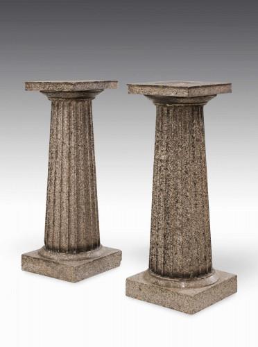 A Pair of Regency Period Granite Column Pedestals