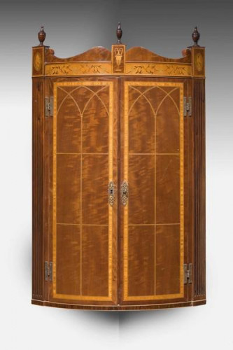 Bow Fronted Corner Cupboard in the manner of Thomas Sheraton