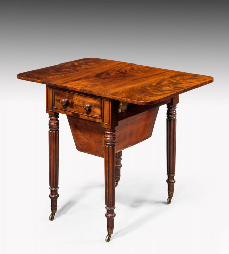 Regency period mahogany Pembroke work table with a sewing basket
