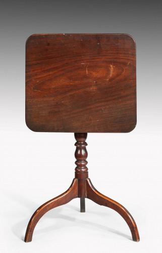 George III period mahogany tilt table over three umbrella legs