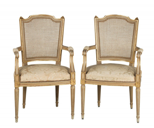Pair of early 20th Century French Painted and Parcel Gilt Elbow Chairs
