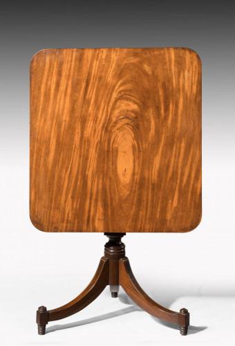 Early 19th century mahogany tilt table on sabre legs