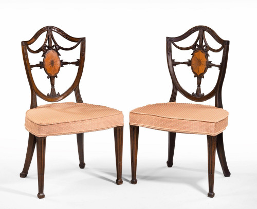 A Finely Carved Pair of Late George III Period Mahogany Hepplewhite Chairs