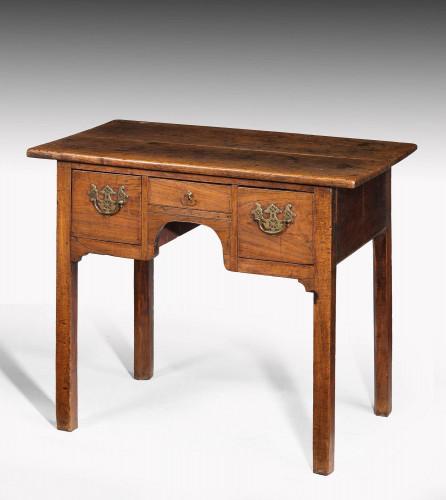 George II period elm lowboy with three shaped drawers