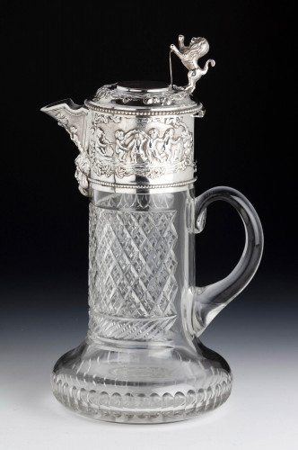 An Attractive Early 20th Century Silver Topped Claret Jug.