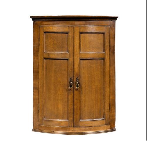 A Handsome George III Period Oak Bow-Fronted Corner Cupboard
