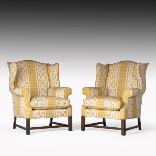 A Substantial Pair of Late 20th Century Serpentine Mahogany Framed Wing Chairs