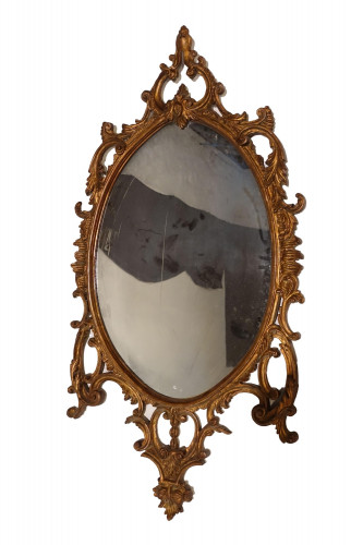 A Chippendale Period Rococo Giltwood Oval Mirror