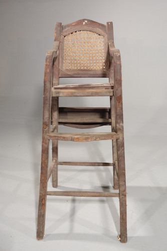 An Early 20th Century Elm Child's Chair.
