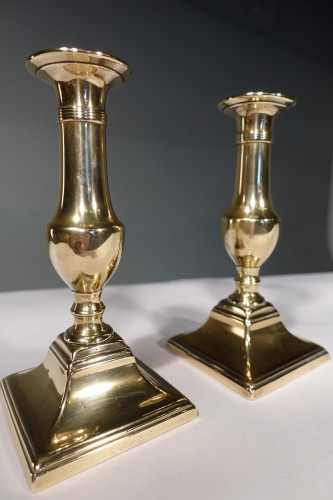 A Pair of George III Period Brass Candlesticks