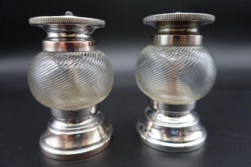 An Unusual Pair of Late 19th Century Silver Plate and Glass Pepper Mills