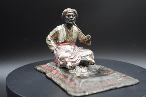 A Finely Modelled Late 19th Century Austrian Figure of an Arabian Man Smoking a Pipe