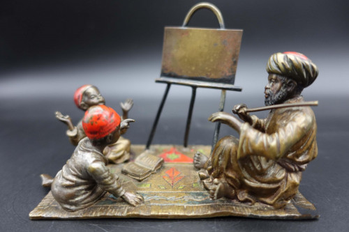 A Late 19th Century Austrian Bronze of a Music Teacher with Two Pupils