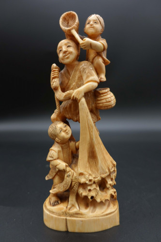 An Early 20th Century Complex Ivory Carving of a Fisherman
