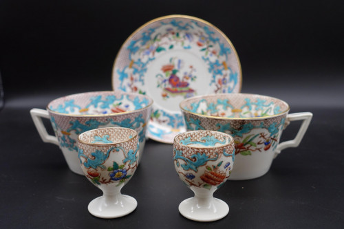A Small Mid 19th Century Porcelain Group of Egg Cups, Cups and Saucer