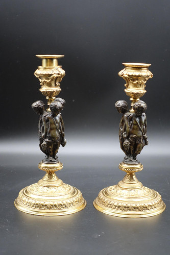 A Charming Pair of Late 18th Century Bronze and Gilt Bronze Candlesticks
