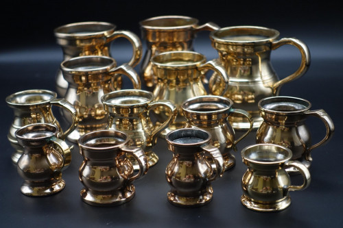 A Rare and Attractive Collection of 13 19th Century Brass Pot-Bellied Tankards
