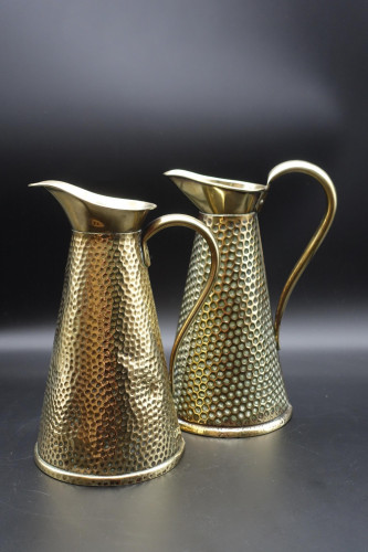A Pair of Early 20th Century Hand Beaten Copper Jugs