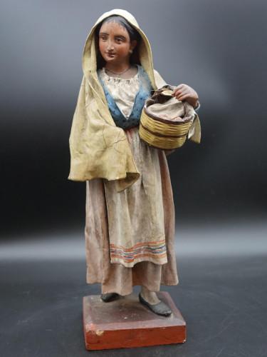 An Attractive Mid 19th Century Papier-Mâché Figure of a Bread Seller