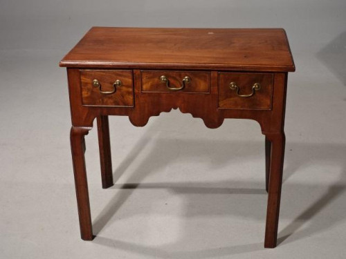 A Late 18th Century Mahogany Lowboy with an Attractive Shaped Front
