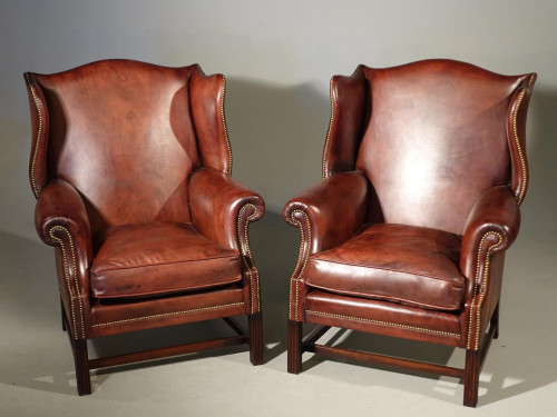 A Handsome Pair of Modern Mahogany Framed Wing Chairs of Chippendale Design