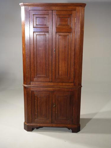 An Exceptional George III Period Oak Double Corner Cupboard