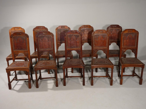 A Tightly Designed Set of 10 Early 20th Century Oak Framed Chairs