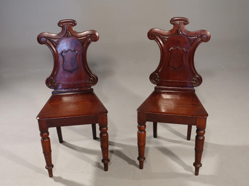 An attractive Pair of Mid 19th Century Mahogany Hall Chairs