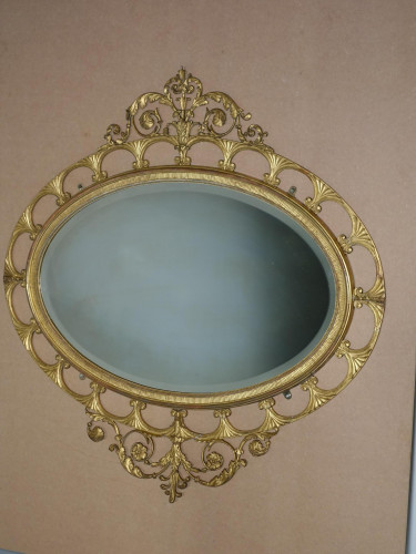 A Most Elegant Oval Giltwood Mirror in the Manner of Gillows of Lancaster