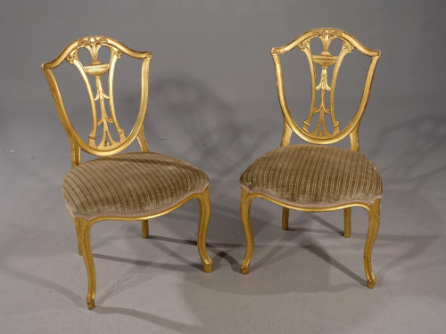 A Rare Pair of Late 18th Century French Hepplewhite Gilded Side Chairs
