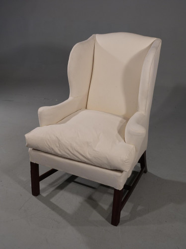 An Early 20th Century Mahogany Framed Wing Chair of Chippendale Design.