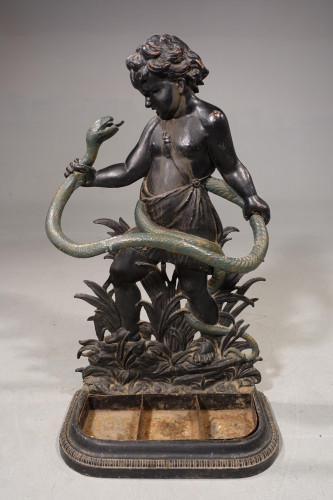 A Good Mid 19th Century Cast-Iron Stick Stand of a Child Wrestling a Serpent