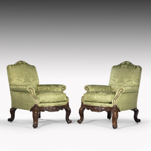 An Exceptional Pair of Late 19th Century Mahogany Framed Easy Chairs