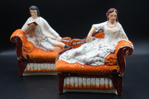 An Unusual Pair of Mid 19th Century Staffordshire Reclining Figures