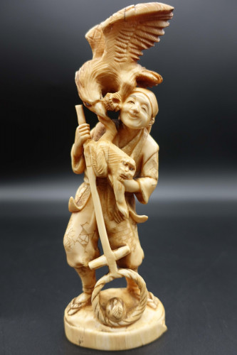 An Early 20th Century Ivory Figure of a Bird of Prey Attempting to Steal a Monkey