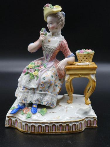 A Late 19th Century Meissen Figure of a Seated Young Lady