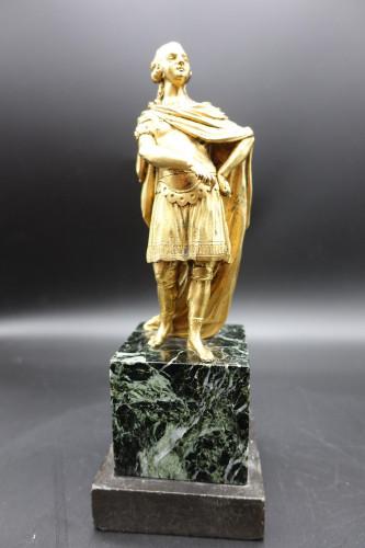 A Mid 18th Century Gilded Bronze Figure of a Senator