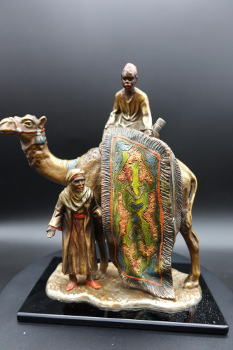A Late 19th Century Bronze Figure of Carpet Seller Astride a Camel