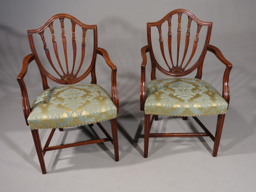 An Exceptional Pair of George III Period Hepplewhite Elbow Chairs