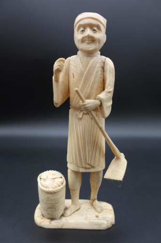An Early 20th Century Ivory Figure of a Workman