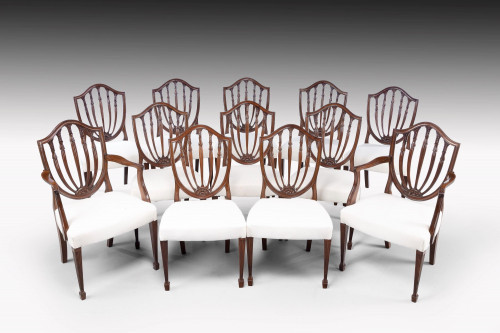 A Fine Early 20th Century Set of 12 (10+2) Classical Hepplewhite Style Chairs