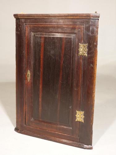A Late Georgian Oak Corner Cupboard