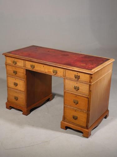 A Late Victorian Oak Kneehole Desk