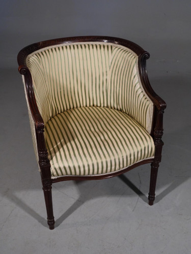 A Finely Carved Edwardian Salon or Tub Chair