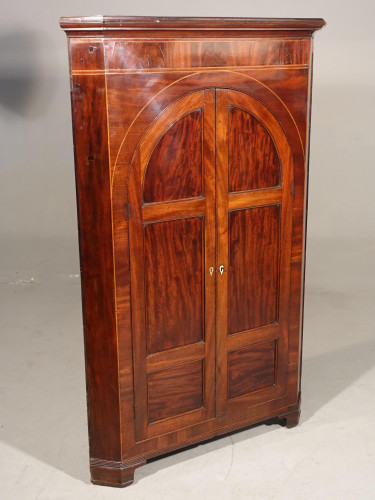 A Regency Period Free Standing Mahogany Corner Cupboard